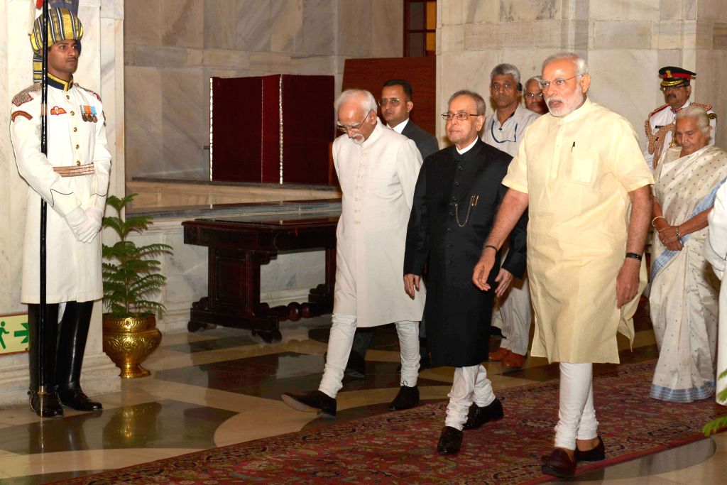 President Pranab Mukherjee, Vice President Mohd. Hamid Ansari and Prime Minister Narendra Modi at the Defence Investiture Ceremony– II, at Rashtrapati Bhavan, in New Delhi on April 26, ... - Narendra Modi and Pranab Mukherjee