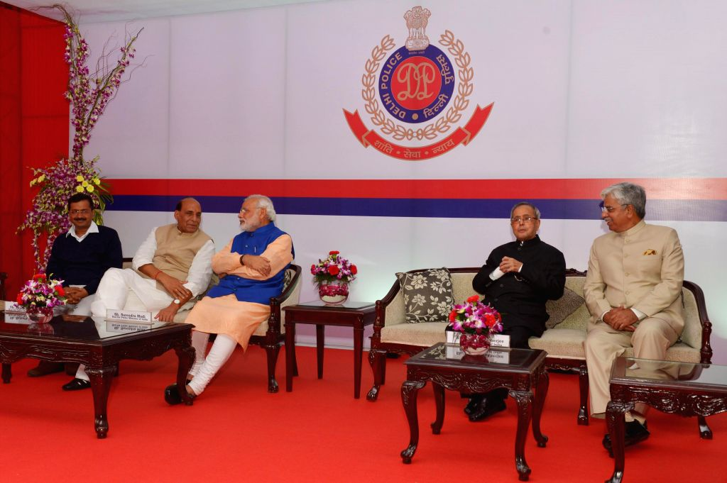 President Pranab Mukherjee with Prime Minister Narendra Modi, Delhi Chief Minister Arvind Kejriwal, Union Home Minister Rajnath Singh and Delhi Police chief B S Bassi during the `At Home` . - Narendra Modi, Pranab Mukherjee, Arvind Kejriwal and Rajnath Singh