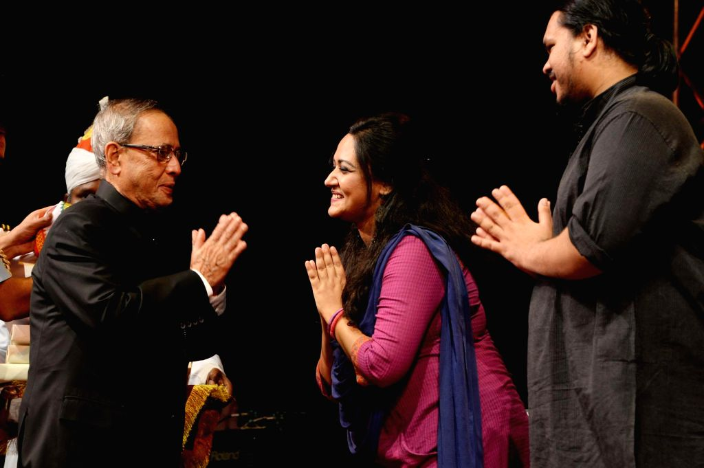 President Pranab Mukherjee with the artists of SAARC Band in New Delhi, on Nov 5, 2014.