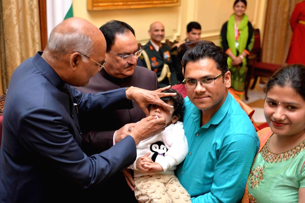 New Delhi: President Ram Nath Kovind administers polio drops to a child at Rashtrapati Bhavan in New Delhi, on March 9, 2019. (Photo: IANS/RB) - Nath Kovind