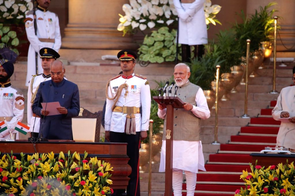 New Delhi: President Ram Nath Kovind administers the oath of office to Narendra Modi as the Prime Minister of India at a swearing-in ceremony at the Rashtrapati Bhavan in New Delhi on May 30, 2019. (Photo: Amlan Paliwal/IANS) - Narendra Modi and Nath Kovind