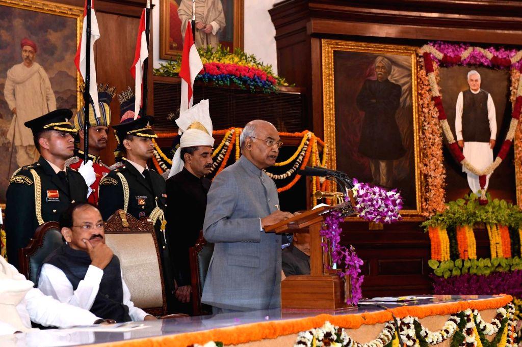New Delhi: President Ram Nath Kovind along with Vice President M. Venkaiah Naidu, Prime Minister Narendra Modi, Lok Sabha Speaker Sumitra Mahajan and Leader of the Opposition in Rajya Sabha, Ghulam Nabi Azad  unveils the portrait ofFormer Prime Minis - Narendra Modi, M. Venkaiah Naidu, Nath Kovind, Sumitra Mahajan and Atal Bihari Vajpayee