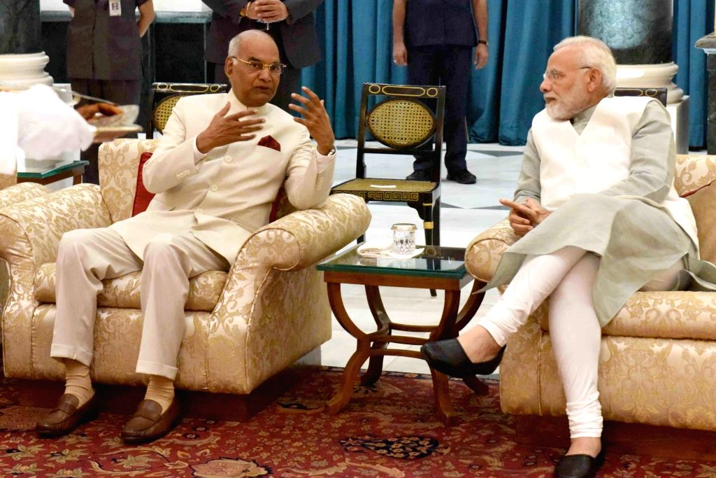 "New Delhi: President Ram Nath Kovind and Prime Minister Narendra Modi during ""Reception"" being organised on the occasion of Civil Service Day at RBCC, President's Estate in New Delhi on April 21, 2018. (Photo: IANS/RB) - Narendra Modi and Nath Kovind"
