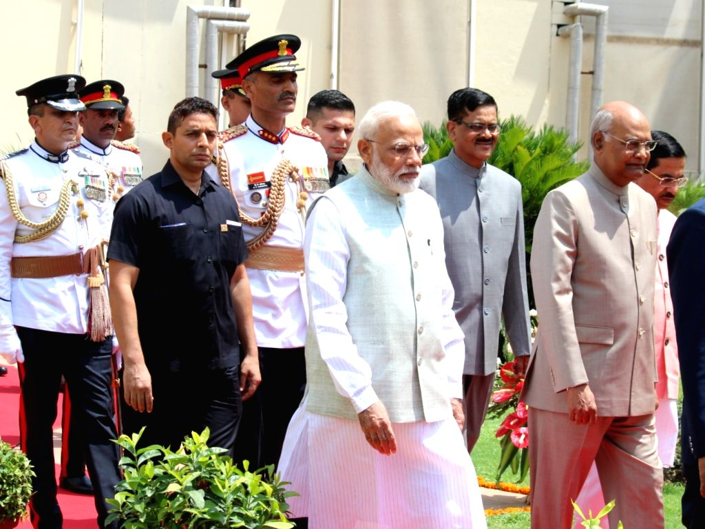 New Delhi: President Ram Nath Kovind and Prime Minister Narendra Modi arrive at Parliament in New Delhi on June 20, 2019. (Photo: Amlan Paliwal/IANS) - Narendra Modi and Nath Kovind
