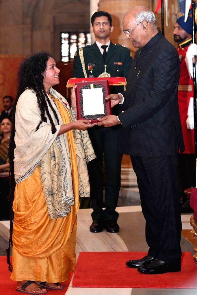 New Delhi: President Ram Nath Kovind confers Sangeet Natak Akademi Award 2017 on folk singer Parvathy Baul during a special investiture ceremony at Rashtrapati Bhawan in New Delhi on Feb 6, 2019. (Photo: IANS/RB) - Nath Kovind