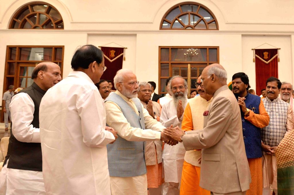 New Delhi: President Ram Nath Kovind, Vice President M. Venkaiah Naidu, Prime Minister Narendra Modi and Defence Minister Rajnath Singh during 'At Home' hosted by him on 73rd Independence Day at Rashtrapati Bhavan, in New Delhi on Aug 15, 2019. (Phot - Narendra Modi, M. Venkaiah Naidu, Nath Kovind and Rajnath Singh