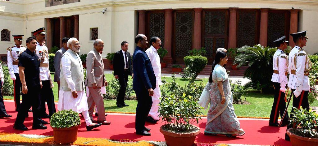 New Delhi: President Ram Nath Kovind, Vice President Venkaiah Naidu, Prime Minister Narendra Modi and Lok Sabha Speaker Om Birla arrive at Parliament, in New Delhi on June 20, 2019. (Photo: IANS/PIB) - Narendra Modi, Venkaiah Naidu and Nath Kovind