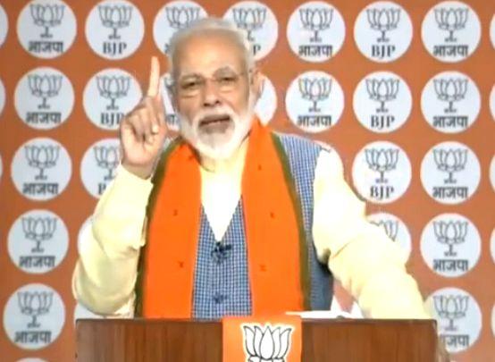 New Delhi: Prime Minister and BJP leader Narendra Modi addresses party workers via NaMo app, in New Delhi, on Feb 28, 2019. (Photo: IANS/BJP) - Narendra Modi