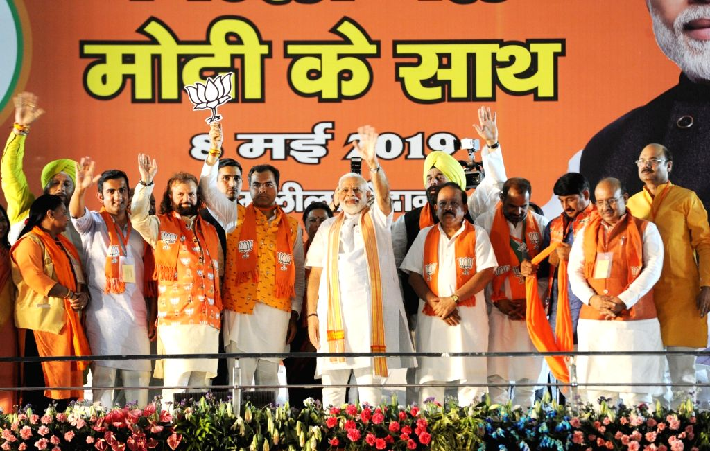 New Delhi: Prime Minister and BJP leader Narendra Modi along with party's Lok Sabha candidates from Delhi during a public rally at Ramlila Ground in New Delhi, on May 8, 2019. (Photo: IANS) - Narendra Modi