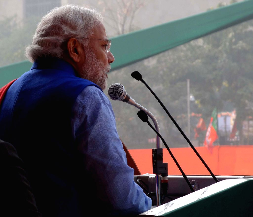 Prime Minister Narendra Modi addresses during a BJP rally to celebrate party's success in the recently concluded assembly polls in Jharkhand and Jammu and Kashmir at Ramlila Maidan in New . - Narendra Modi