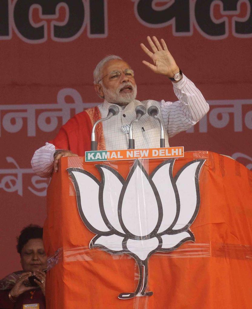 Prime Minister Narendra Modi addresses a Delhi Assembly Election rally in New Delhi on Feb. 4, 2015. - Narendra Modi