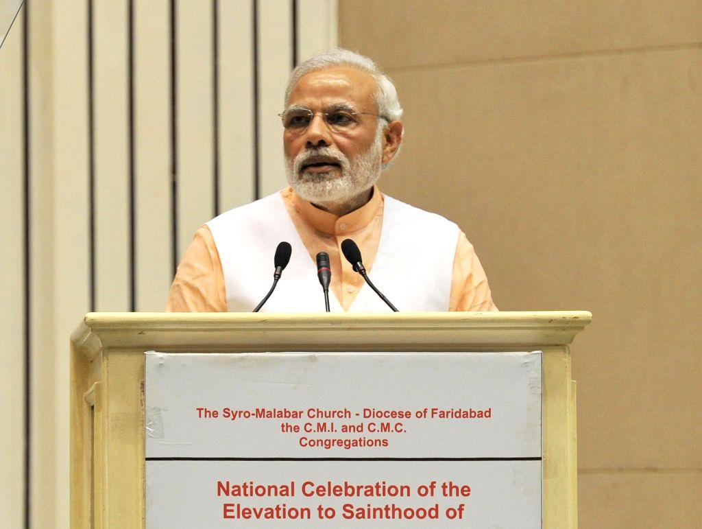 Prime Minister Narendra Modi addresses at a programme organised to celebrate the Elevation to Sainthood of Kuriakose Elias Chavara and Mother Euphrasia, in New Delhi on Feb 17, 2015. - Narendra Modi