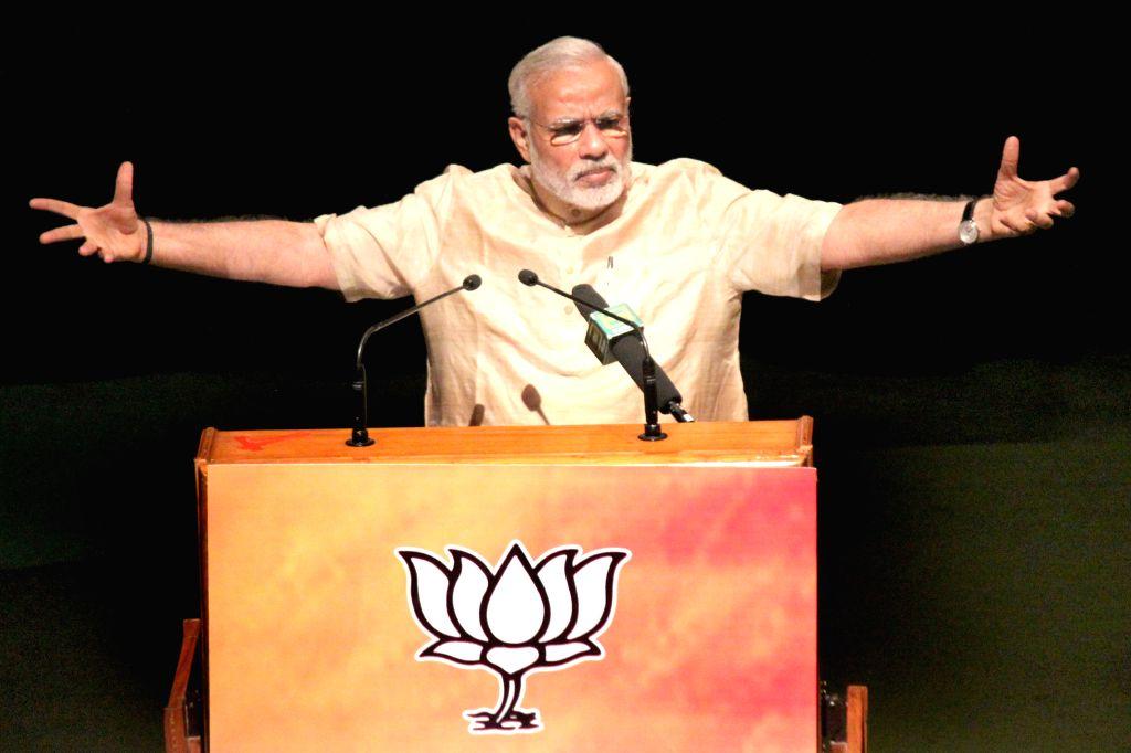 Prime Minister Narendra Modi addresses party MPs during workshop on pro-poor schemes, in New Delhi on April 19, 2015. - Narendra Modi
