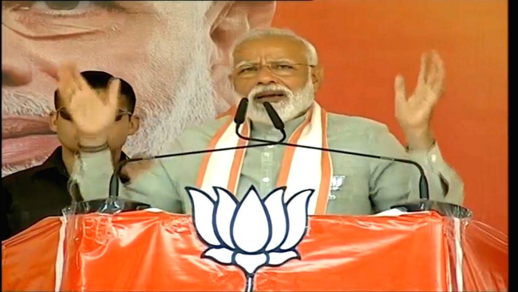 New Delhi: Prime Minister Narendra Modi addresses a BJP rally in Uttar Pradesh's Deoria on May 12, 2019. (Photo: IANS/BJP) - Narendra Modi
