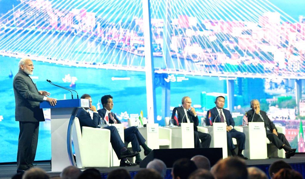 New Delhi: Prime Minister Narendra Modi addresses at the Eastern Economic Forum (EEF) 2019 in Vladivostok, Russia on Sep 5, 2019. Also seen  Japanese Prime Minister Shinzo Abe, Russian President Vladimir Putin, Mongolian President Khaltmaagiin Battul - Narendra Modi