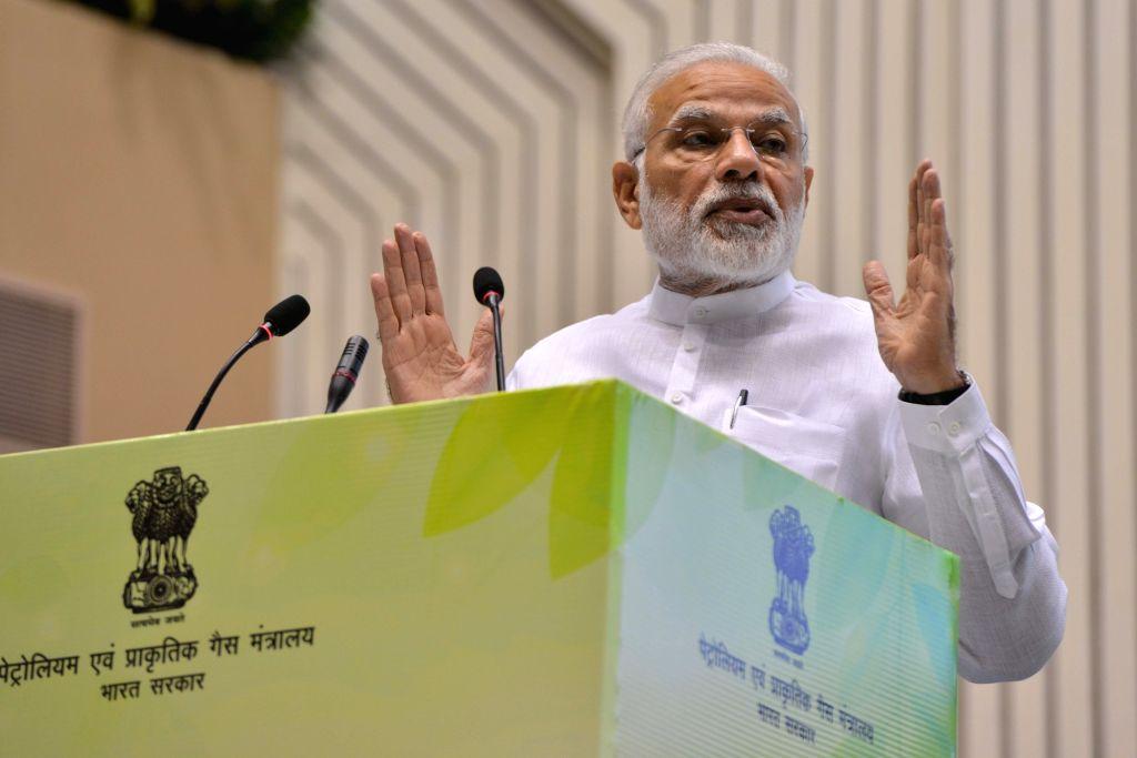 ":New Delhi: Prime Minister Narendra Modi addresses at the inauguration of the ""World Biofuel Day 2018"" programme, in New Delhi, on Aug 10, 2018.(Photo: IANS)."