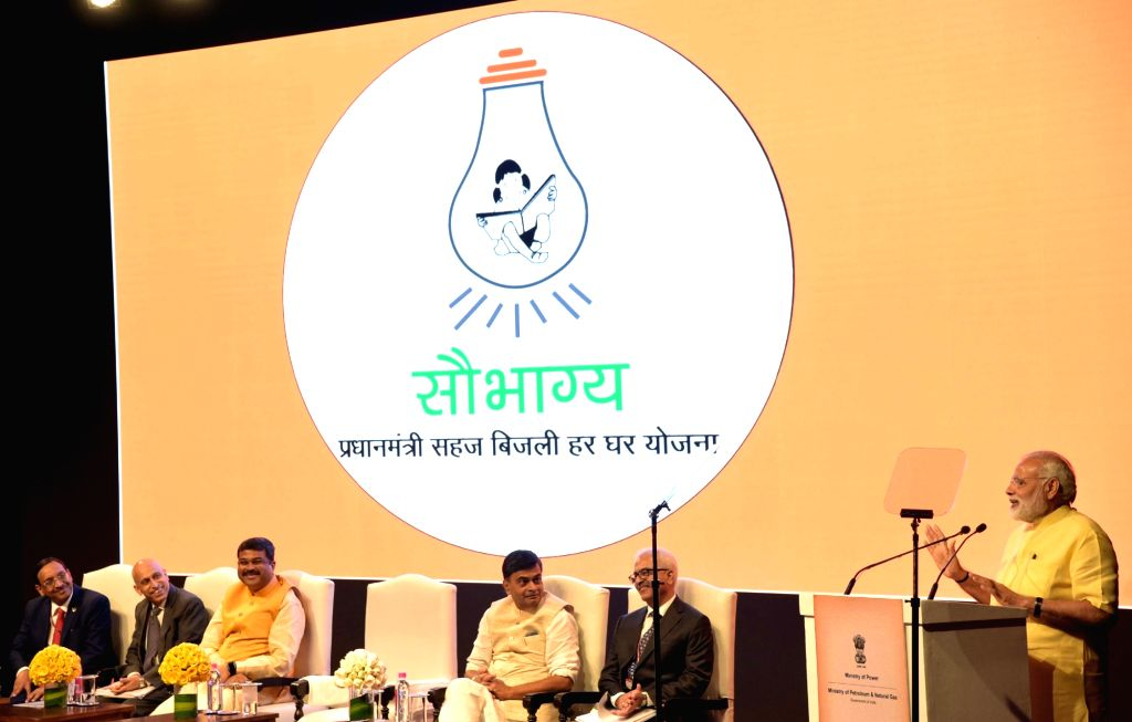 New Delhi: Prime Minister Narendra Modi addresses at the launch of the Pradhan Mantri Saubhagya Yojana at Deendayal Urja Bhawan in New Delhi on Sept 25, 2017. Also seen Union Minister for Petroleum and Natural Gas and Skill Development and Entreprene - Narendra Modi
