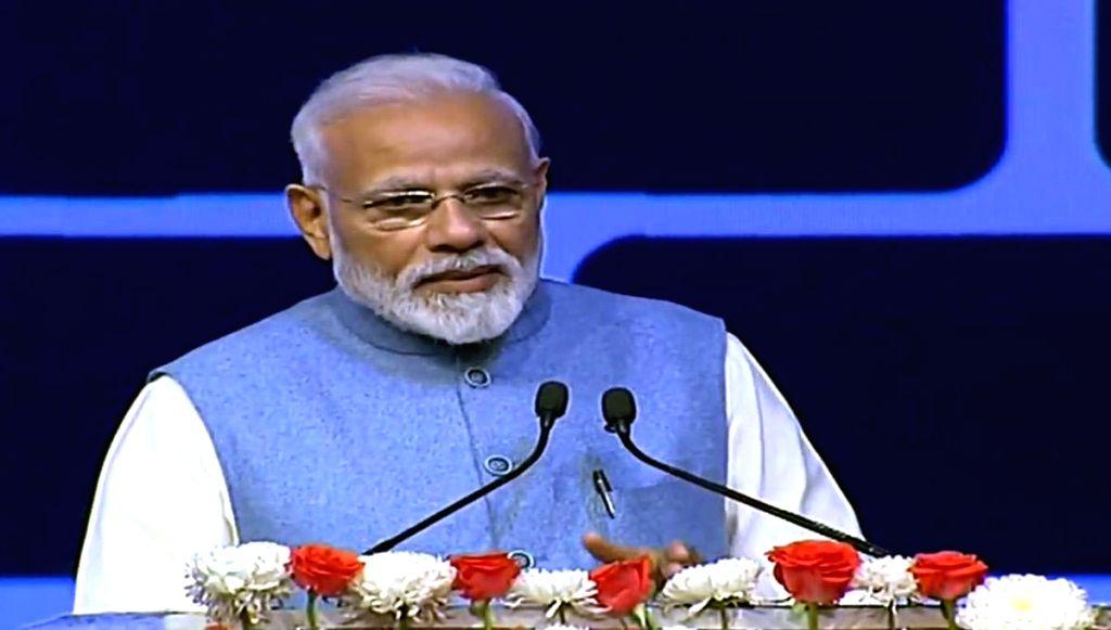 """New Delhi: Prime Minister Narendra Modi addresses during the the """"CREDAI YouthCon 2019"""" in New Delhi on Feb 13, 2019. (Photo: IANS/BJP) - Narendra Modi"""