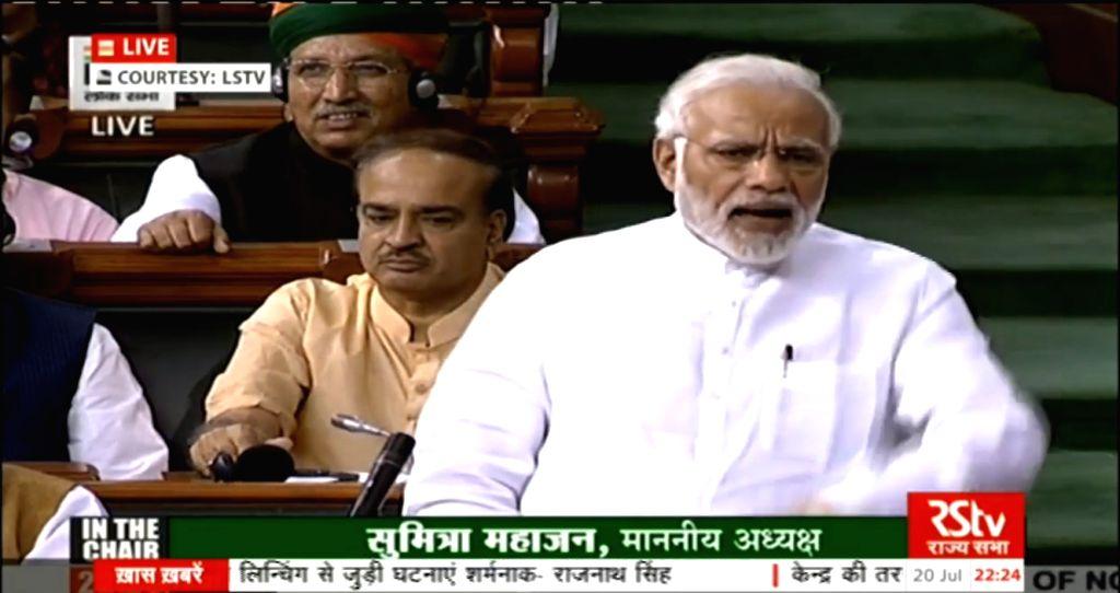 :New Delhi:  Prime Minister Narendra Modi addresses in Lok Sabha in New Delhi on July 20, 2018. (Photo: IANS/LSTV Grab).