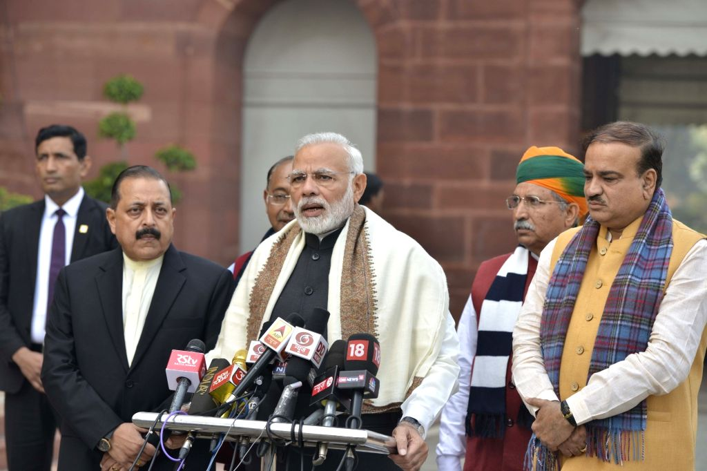 :New Delhi: Prime Minister Narendra Modi addresses press ahead of the Budget Session of Parliament in New Delhi, on Jan 29, 2018. Also seen Union Parliamentary Affairs Ananth Kumar, Union MoS Prime ...