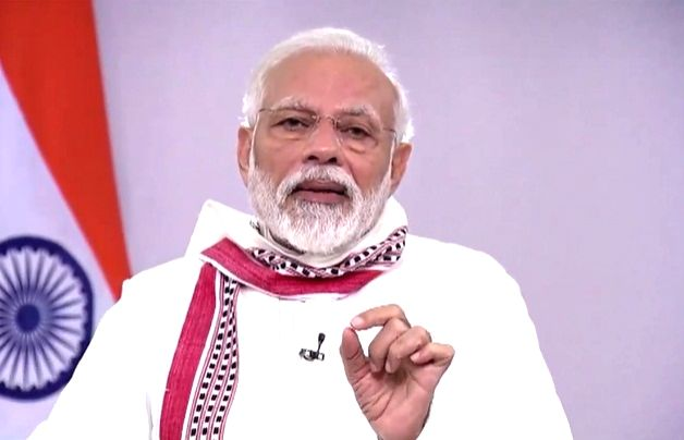 New Delhi: Prime Minister Narendra Modi addresses the nation on the issues related to COVID-19 and existing lockdown, in New Delhi on Apr 14, 2020. The PM on Tuesday commended people of the nation for celebrating festivals by staying at home during t - Narendra Modi