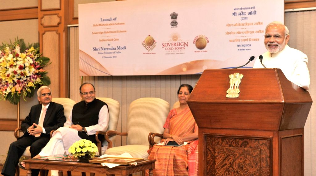 :New Delhi: Prime Minister Narendra Modi addressing at the launches of the Gold schemes, in New Delhi on November 05, 2015. The Union Minister for Finance, Corporate Affairs and Information and ... - Narendra Modi