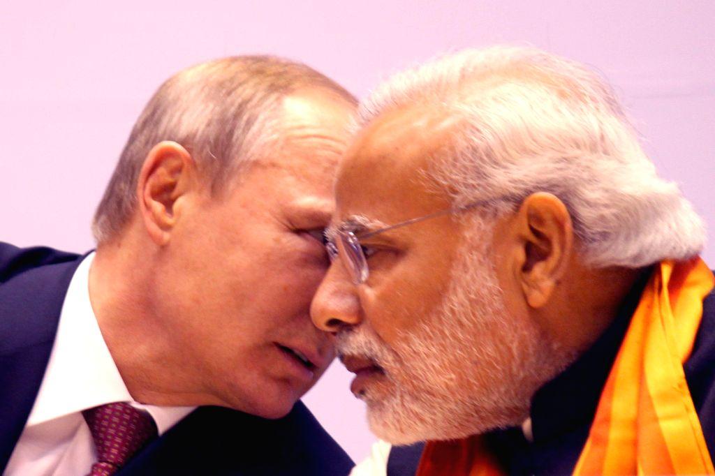 """Prime Minister Narendra Modi and Russian President Vladimir Putin at the """"World Diamond Conference"""" in New Delhi, on Dec 11, 2014. - Narendra Modi"""