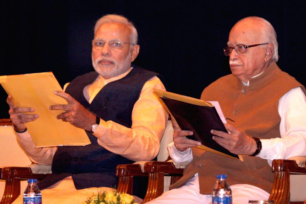 Prime Minister Narendra Modi and BJP veteran and Gandhinagar MP L K Advani during the BJP parliamentary meeting at Parliament library in New Delhi, on March 10, 2015. - Narendra Modi and L K Advani