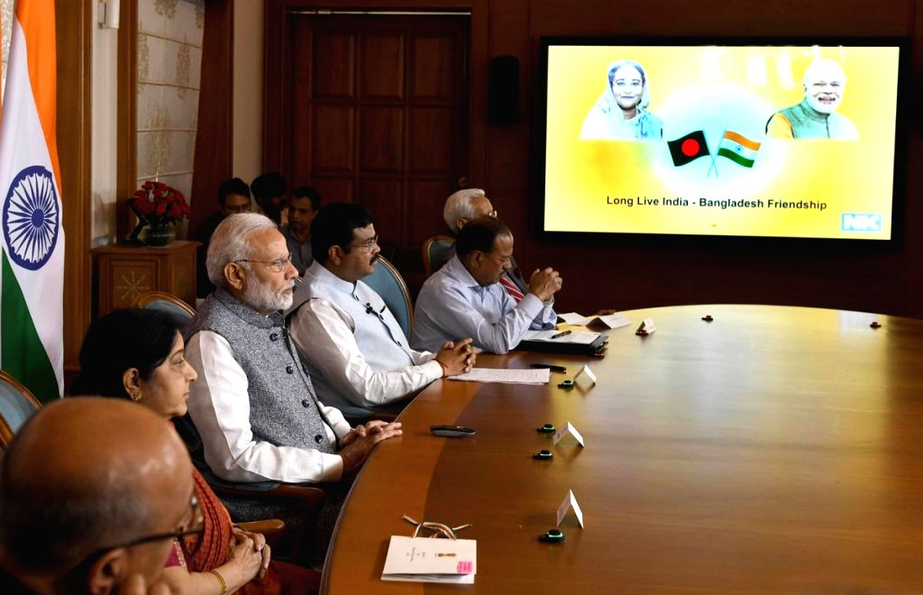 :New Delhi: Prime Minister Narendra Modi and his Bangladeshi counterpart Sheikh Hasina jointly unveil e-plaques for the ground-breaking ceremony of two projects - India-Bangladesh Friendship ...