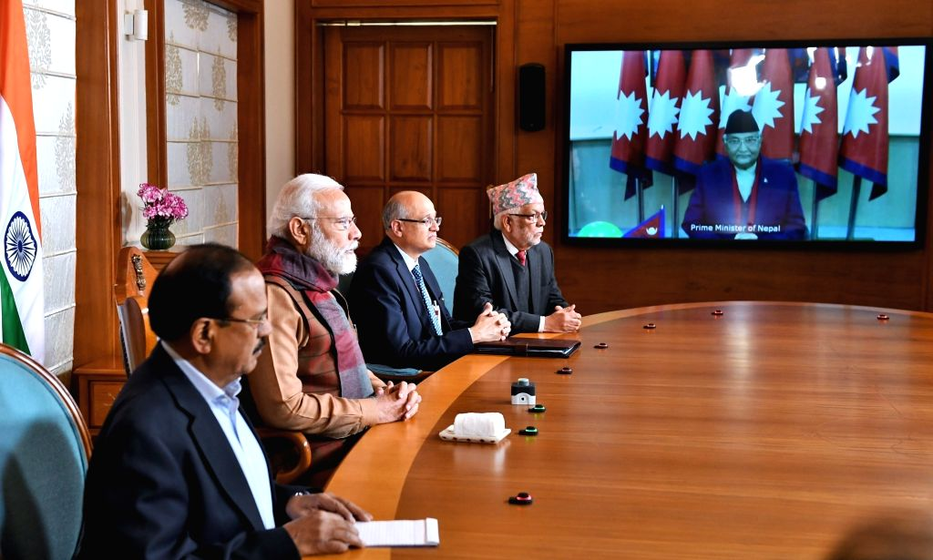 New Delhi: Prime Minister Narendra Modi and his Nepalese counterpart KP Sharma Oli jointly inaugurate the second Integrated Check Post (ICP) at Jogbani - Biratnagar through Video Conferencing, on Jan 21, 2020. Also seen National Security Advisor Ajit - Narendra Modi