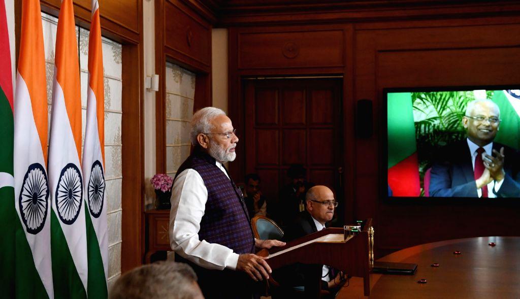 New Delhi: Prime Minister Narendra Modi and Maldives President Ibrahim Mohamed Solih jointly inaugurate the key development projects in Maldives via video conference, in New Delhi on Dec 4, 2019. (Photo: IANS/PIB) - Narendra Modi