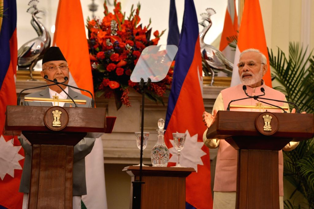 :New Delhi: Prime Minister Narendra Modi and Nepalese Prime Minister K.P. Sharma Oli issue the Joint Press Statement at Hyderabad House in New Delhi on April 7, 2018. (Photo: IANS).