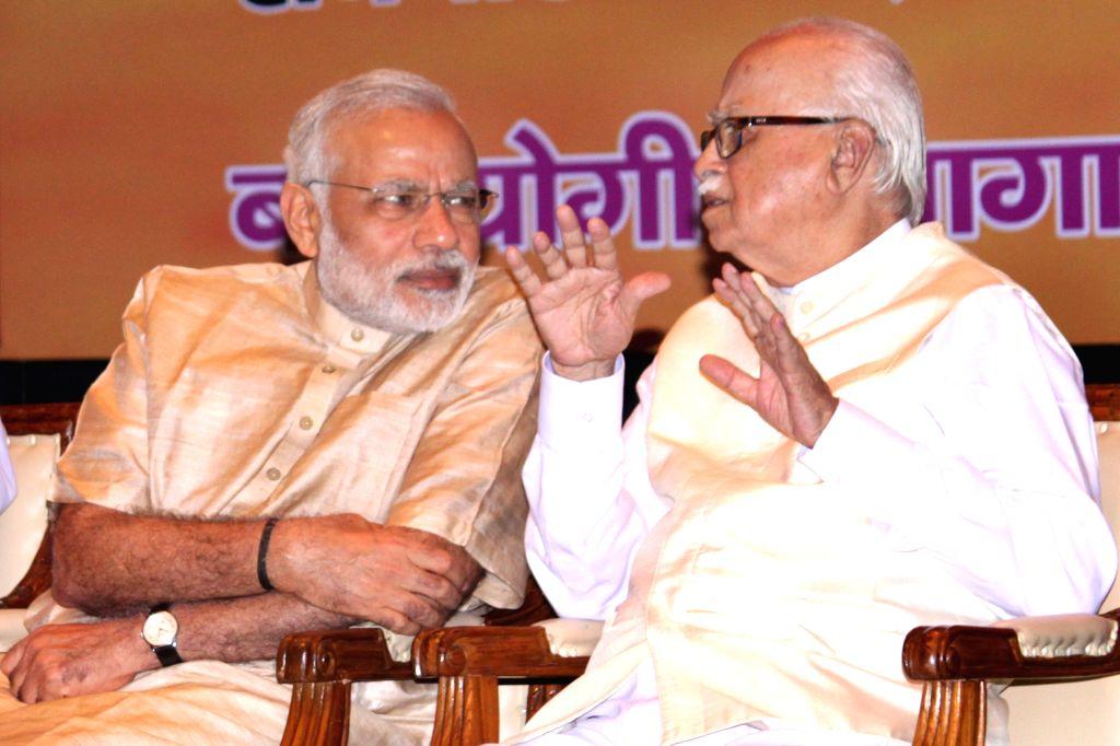 Prime Minister Narendra Modi and senior BJP leader L K Advani, at the Bharatiya Janata Party's workshop for  Members of Parliament, on pro-poor schemes, in New Delhi on April 19, 2015. - Narendra Modi and L K Advani
