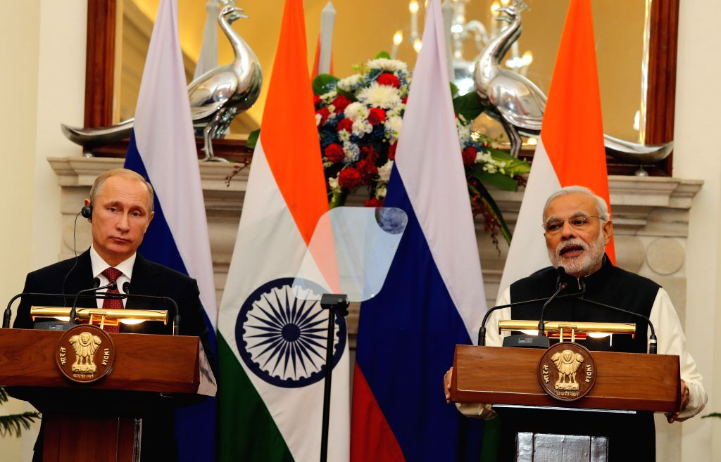 Prime Minister Narendra Modi and the President of the Russian Federation, Vladimir Putin at a joint press conference, in New Delhi on Dec 11, 2014. - Narendra Modi