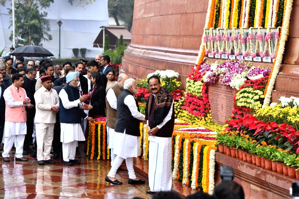 New Delhi: Prime Minister Narendra Modi and Union Home Minister Amit Shah pay tributes to the martyrs on 18th anniversary of Parliament attack at Parliament House in New Delhi on Dec 13, 2019. Also seen Former Prime Minister Manmohan Singh, Vice Pres - Narendra Modi, Thawar Chand Gehlot, Pralhad Joshi, M. Venkaiah Naidu, Amit Shah, Manmohan Singh and Anand Sharma
