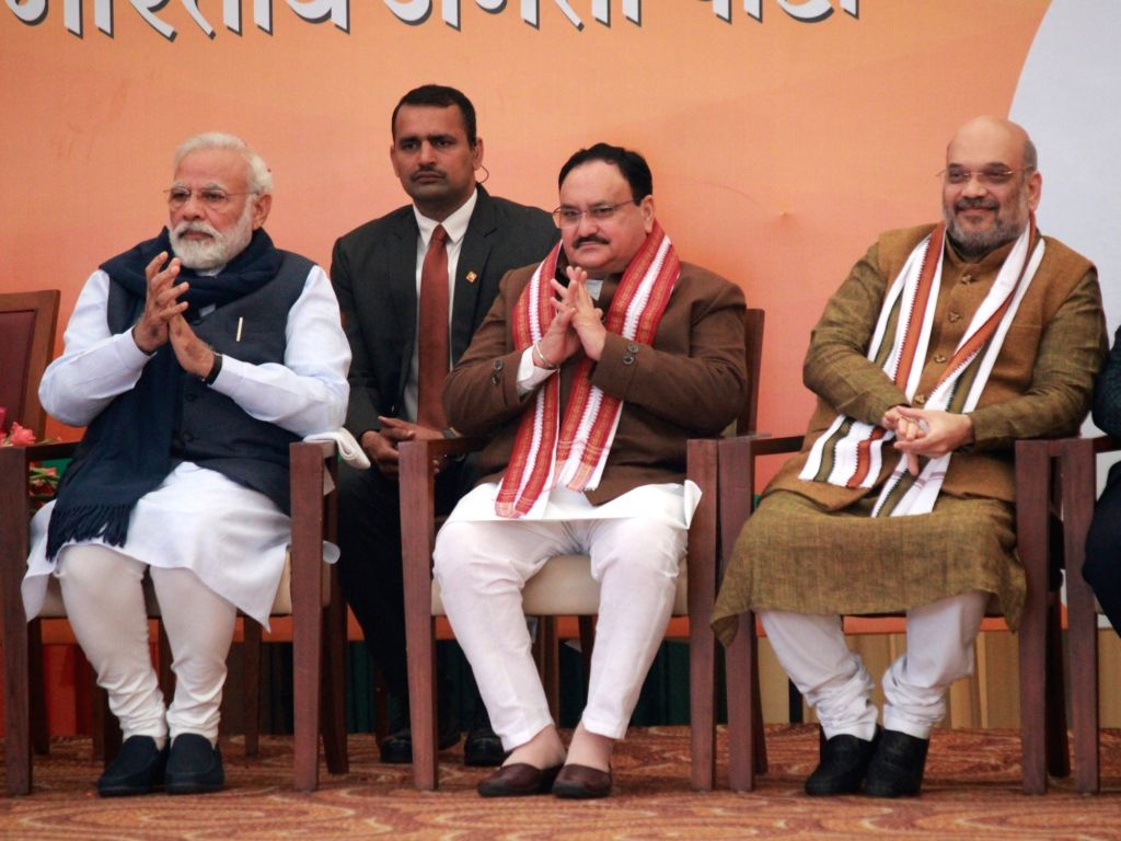 New Delhi: Prime Minister Narendra Modi and Union Home Minister Amit Shah with the newly appointed BJP National President JP Nadda at a felicitation programme organised for him at the BJP Headquarters in New Delhi on Jan 20, 2020. (Photo: Amlan Paliw - Narendra Modi and Amit Shah