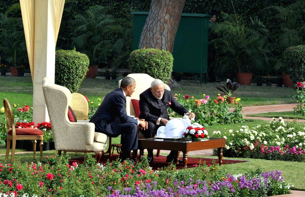 Prime Minister Narendra Modi and US President Barack Obama during meeting over a cup of tea at the Hyderabad House garden in New Delhi, on Jan 25, 2015. - Narendra Modi