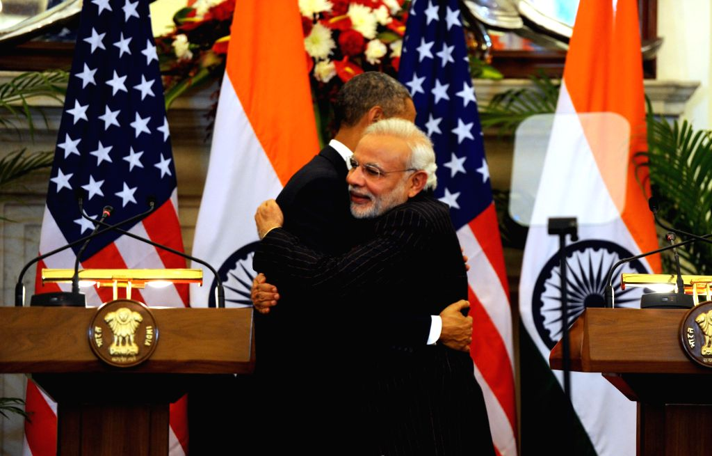 Prime Minister Narendra Modi and US President Barack Obama hug each other during the Joint Press Interaction held at the Hyderabad House, in New Delhi on Jan 25, 2015. - Narendra Modi