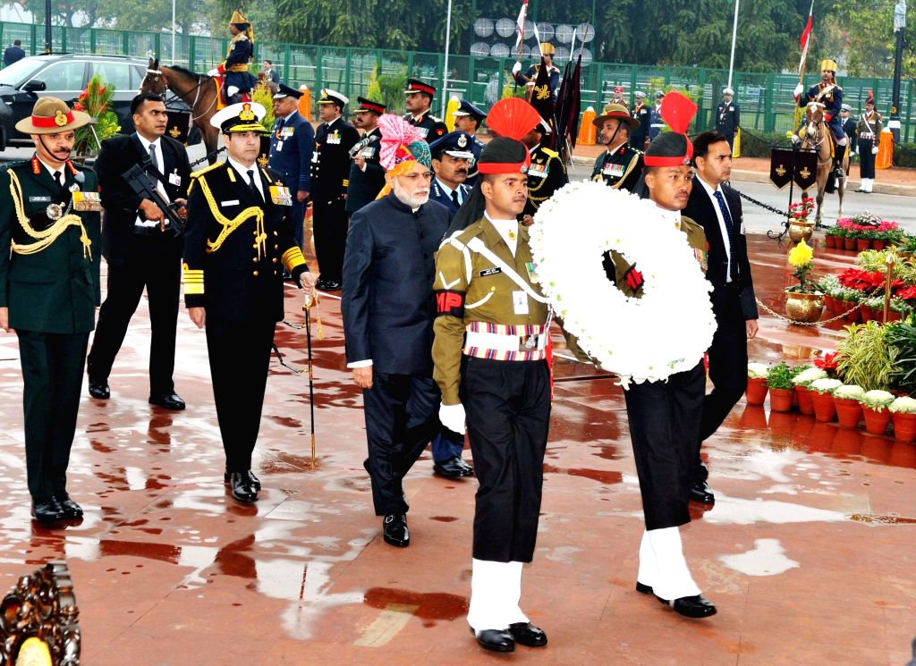 Prime Minister Narendra Modi arrives at Amar Jawan Jyoti, India Gate, on the occasion of the 66th Republic Day Parade 2015, in New Delhi on Jan 26, 2015.