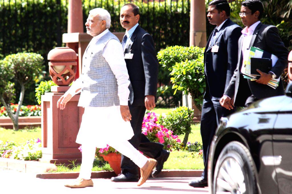 Prime Minister Narendra Modi arrives at the Parliament in New Delhi, on March 9, 2015. - Narendra Modi