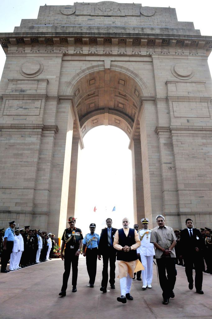 Prime Minister Narendra Modi at Amar Jawan Jyoti on the occasion of the Centenary commemoration of World War -I, in New Delhi on March 10, 2015. Also seen the Union Minister for Defence ... - Narendra Modi