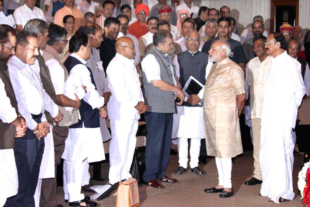 Prime Minister Narendra Modi at the Bharatiya Janata Party`s workshop for Members of Parliament , on pro-poor schemes, in New Delhi on April 19, 2015. - Narendra Modi