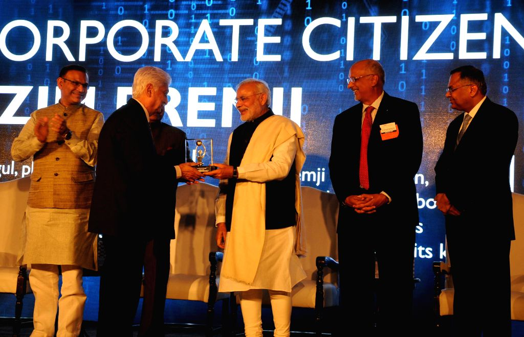 Prime Minister Narendra Modi being felicitated by the Chairman of Nasscon R.Chandrasekaran during a programme organised on the 25th Foundation Day of Nasscom in New Delhi, on March 1, ... - Narendra Modi