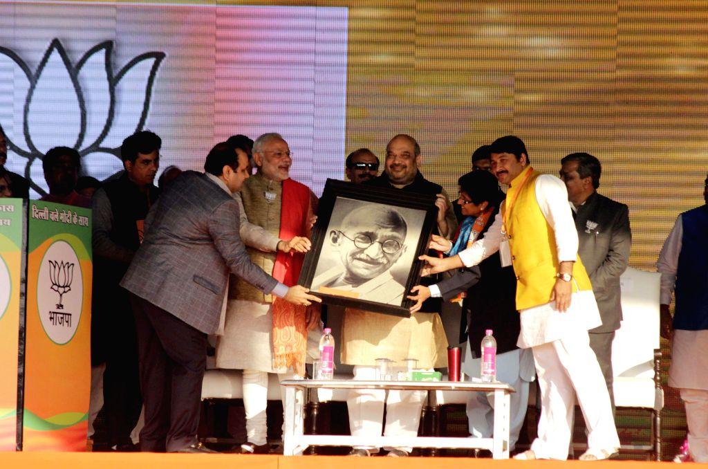 Prime Minister Narendra Modi, BJP president Amit Shah, BJP leaders Kiran Bedi, BJP MP Manoj Tiwari during an election rally in New Delhi on Jan. 31, 2015. - Narendra Modi, Amit Shah and Kiran Bedi