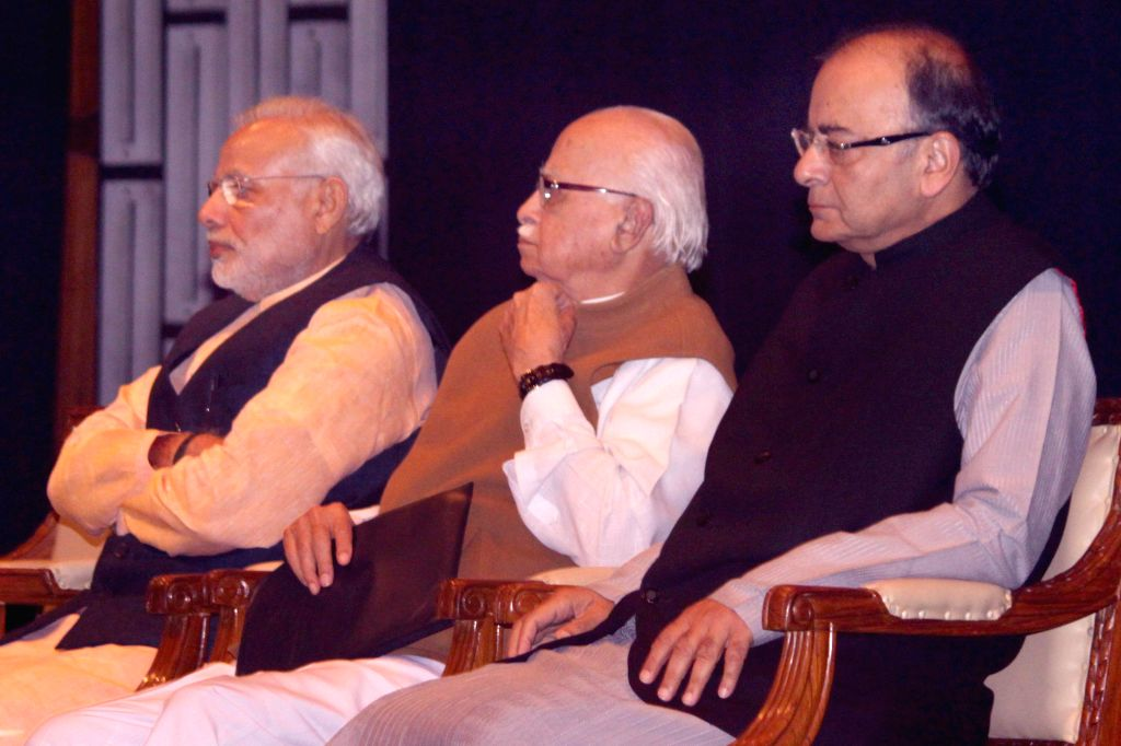 Prime Minister Narendra Modi, BJP veteran and Gandhinagar MP L K Advani and Union Minister for Finance, Corporate Affairs, and Information and Broadcasting Arun Jaitley during the BJP ... - Narendra Modi, L K Advani and Arun Jaitley