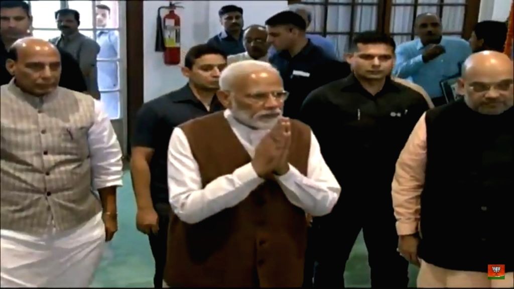 New Delhi: Prime Minister Narendra Modi, BJP chief Amit Shah and Union Minister Rajnath Singh arrive to attend the NDA Parliamentary Board meeting at Parliament in New Delhi on May 25, 2019. (Photo: IANS) - Narendra Modi, Amit Shah and Rajnath Singh