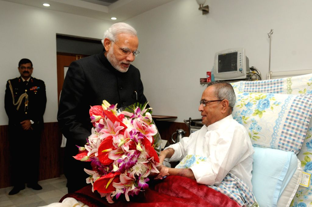 Prime Minister Narendra Modi calls on President Pranab Mukherjee to enquire about his health at Army (Research and Referral) Hospital in New Delhi  on Dec 16, 2014. The President  ... - Narendra Modi and Pranab Mukherjee