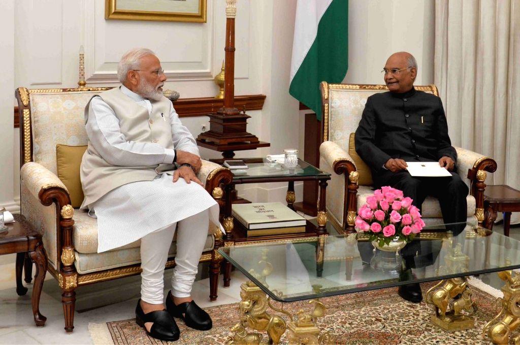 New Delhi: Prime Minister Narendra Modi calls on President Ram Nath Kovind to submit his resignation at Rashtrapati Bhavan in New Delhi on May 24, 2019. (Photo: IANS/RB) - Narendra Modi and Nath Kovind