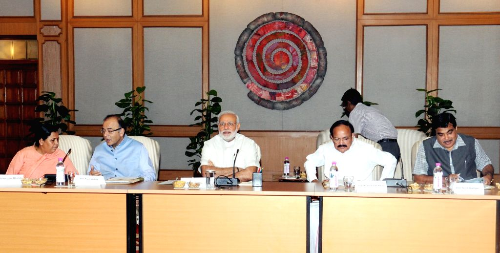 Prime Minister Narendra Modi chairs a meeting on the National Ganga River Basin Authority, in New Delhi on March 26, 2015. Also seen the Union Minister for Finance, Corporate Affairs, and ... - Narendra Modi, M. Venkaiah Naidu and Arun Jaitley