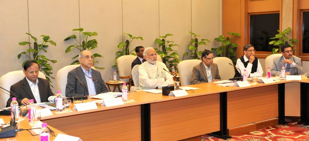 : New Delhi: Prime Minister Narendra Modi chairs a review meeting under PRAGATI, on the progress of works across various infrastructure sectors, in New Delhi on Nov 9, 2015. (Photo: IANS/PIB).